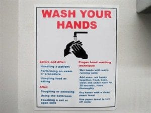 Figure 2. Various methods, such as posting reminders in patient care areas, are useful in promoting proper hand hygiene