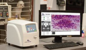 FIGURE 5. This Microview system automates the process of smearing, staining, and viewing blood smears and other types of samples and captures a digital image of the slide. (Photo courtesy of Revo Squared. Kennesaw, GA. revosquared.com/microview.html)