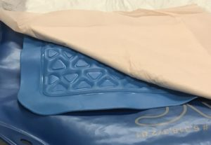 FIGURE 1. Layers, Hug-U-Vac, warm water blanket, huck pad. Image courtesy of Brenda Feller.
