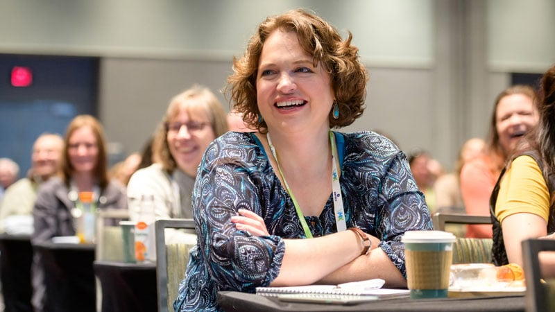 VMX Attendee Smiling During Veterinary CE Session